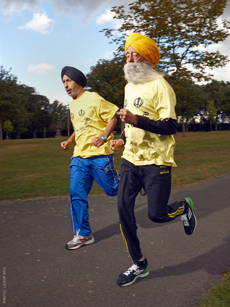 Fauja Singh runs with Coach Harmander Singh in London