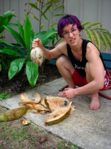 Behold! I have slain the mighty coconut with my pointed stick and smashy rock! Also notice my squat depth!