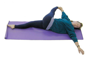 Revolved_Supine_Hand_to_Foot_Pose_05
