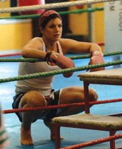 In between beatdowns, MMA fighter Gina Carano demonstrates hip flexion.